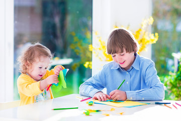 Children painting Easter crafts