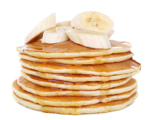 Stack of delicious pancakes with slices of banana and honey
