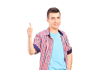 Casual young guy giving thumb up