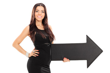 Classy woman holding a big arrow pointing right
