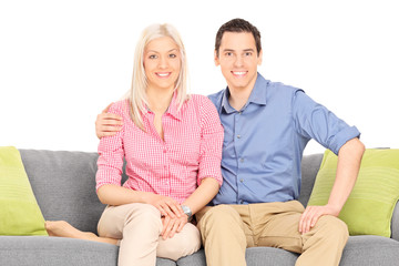 Young couple sitting on a modern sofa