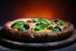 Italian pizza on wooden board dark colorful background