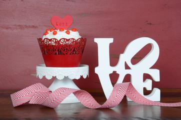 Valentine red velvet cupcakes on wood background