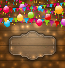 Colorful balloons, hanging flags on wooden texture, place for yo