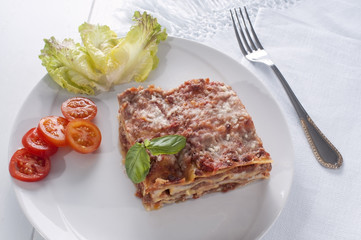 serving a lasagna on a plate