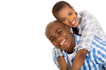 young black couple piggybacking