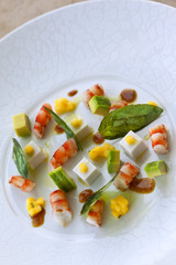 Salad of prawns, coconut, jelly, mango and avocado