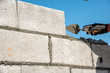 worker build concrete wall by cement block and plaster  - 76231022