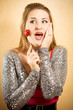 portrait of excited woman holding decorative heart on stick