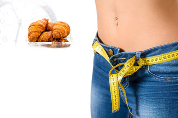 Young woman wearing jeans  after diet and food background