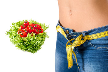 Young woman wearing jeans  after diet  with food background