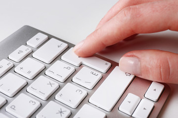 Female hand with keyboard on white background