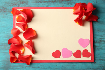 Beautiful hand made post card with paper hearts and rose petals