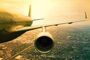 plane flying above urban scene