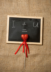 love on black chalkboard against linen cloth
