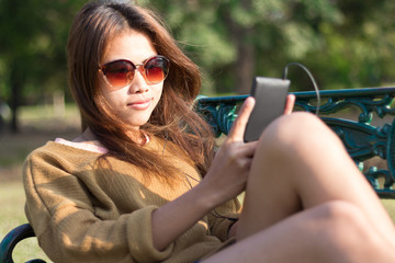 pretty women take relax use smart phone  mobile at evening