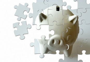 piggy bank made of puzzle - economy and finance