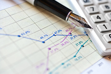 finance and business - financial graph in office