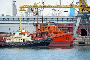 Bunker ship and tugboat under port crane, Odessa, Ukraine