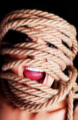 Tied up scared woman face.