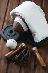 Variety of sports equipment over wooden background, studio shot