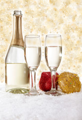 Glasses of champagne and red santa hat with decoration
