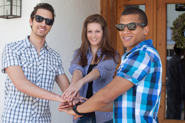 Group of teenager - young people - hands together