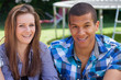 couple smiling at camara