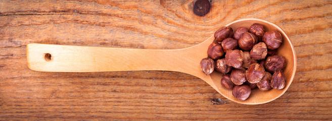 Hazelnuts in wooden spoon