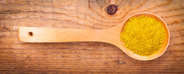 curry powder spices on spoons