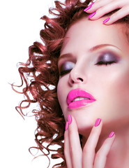 Beautiful brunette woman with bright make up and manicure.