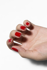 Hand with red color nail varnish