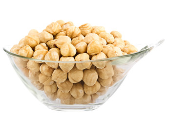 hazelnuts in glass piala. Isolation on white background