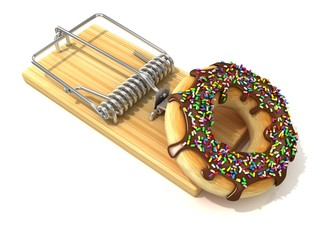 Chocolate doughnut with sprinkles, in wooden mousetrap