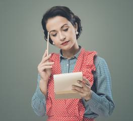 Housewife writing down a shopping list