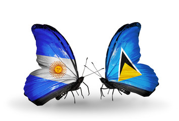 Two butterflies with flags Argentina and Saint Lucia