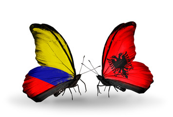 Two butterflies with flags Columbia and Albania