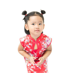 Cute asian girl in red chinese dress isolated on the white backg