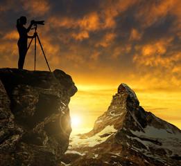 Photographer photographing the sunset over the Matterhorn