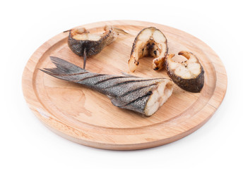 Grilled steaks and tail of seabass.