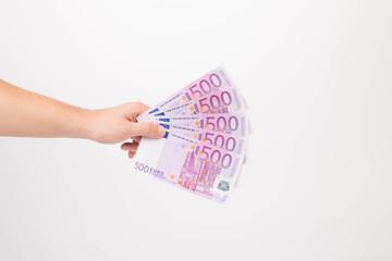 Euro notes aligned as fan in hand.