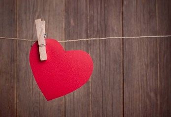Red paper heart hanging on the clothesline