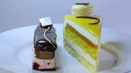 delicious bright cakes on  plate