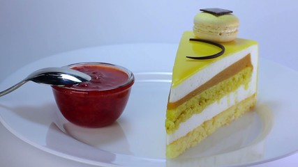 beautiful yellow cake with jam and spoon