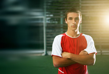 portrait of soccer player with his arms crossed in training