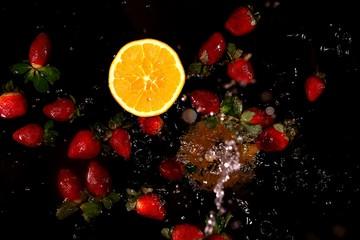 Stillleben - Orange und Erdbeeren