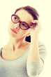 Thoughtful woman in eyeglasses.
