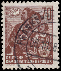 Stamp printed in GDR, shows a family