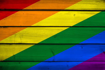 Rainbow Flag on wood background