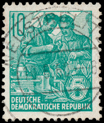 Stamp printed in GDR, shows workers